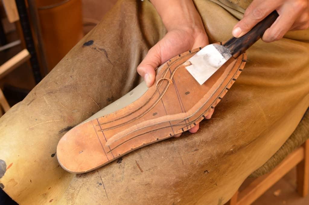 På en Goodyear-randsydd sko